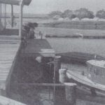 an old picture of a marina